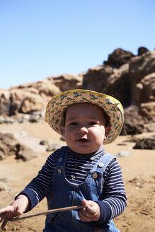 Portrait of little boy playing at the beach. Menorca, Spain. - IGGF00898