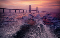 Cable-stayed bridge over sea during sunset - ASTF04772