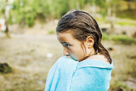 Side view of thoughtful girl wrapped in towel at lakeshore - ASTF05007