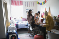 Female college students studying in dorm room - HEROF24719