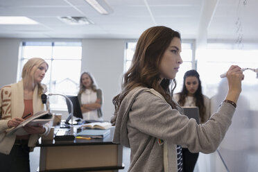 Female college students at whiteboard in classroom - HEROF24746