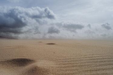 Spain, Tarifa, cloudy sky over sand dune - OCMF00296
