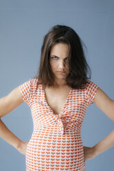 Woman pretending to be pregnant, looking angry - KNSF05680