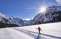 Austria, Tirol, Riss Valley, Karwendel, cross country skier in winter landscape - MRF01918