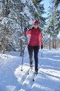 Germany, Bavaria, Wallgau, Isar Valley, Canada trail, cross country skier in winter landscape - MRF01924