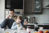 Father and daughter in kitchen in the morning - HEROF25067