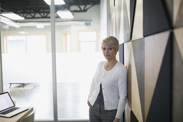 Portrait of confident businesswoman in conference room - HEROF25367