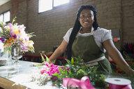Portrait smiling florist in flower shop - HEROF25388
