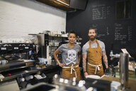 Portrait confident hipster baristas in coffee shop - HEROF25400