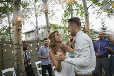 Bride and groom dancing at backyard wedding reception - HEROF25526