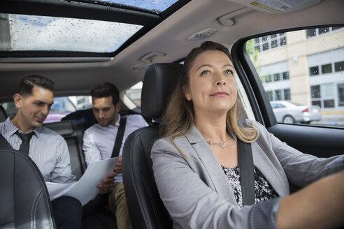 Business people carpooling in car - HEROF25544