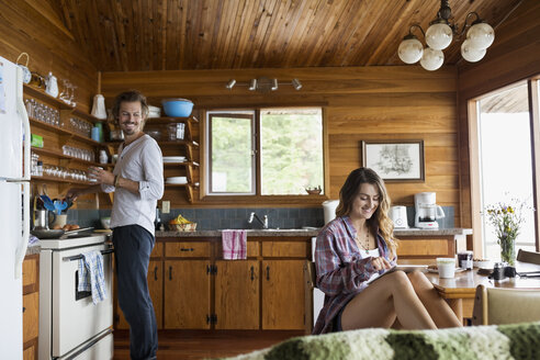Young couple in cabin kitchen - HEROF25676