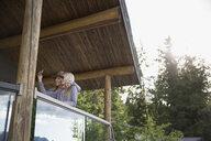 Young women taking selfie on cabin balcony - HEROF25694