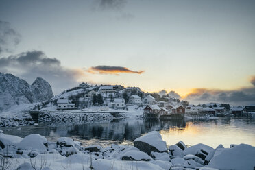 Tranquil snow covered waterfront fishing village, Reine, Lofoten Islands, Norway - CAIF22624