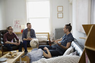 Homosexual and heterosexual couples hanging out living room - HEROF26052