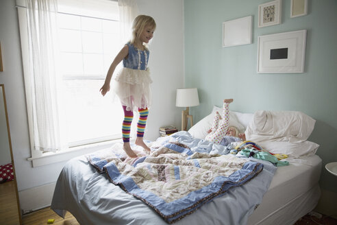 Girl in tutu jumping on bed - HEROF26070