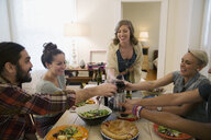 Friends toasting wine glasses at dinner party - HEROF26088