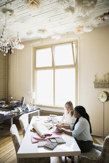 Interior designers looking at swatches in office - HEROF26106