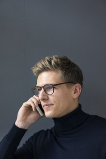 Portrait of young man on cell phone - MOEF02137