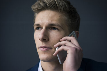 Portrait of young businessman on cell phone - MOEF02155
