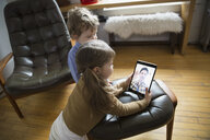 Children video conferencing with father on digital tablet - HEROF26168