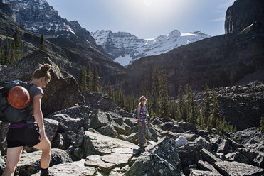 Women hiking in majestic, craggy mountain landscape, Yoho Park, British Columbia, Canada - CAIF22782