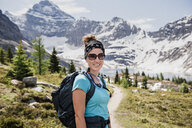 Portrait confident female hiker on sunny, idyllic mountain trail, Yoho Park, British Columbia, Canada - CAIF22788