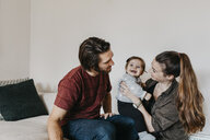 Happy family with baby girl at home - LHPF00463