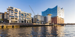 Germany, Hamburg, HafenCity, Elbe Philharmonic Hall, Sandtorhafen and modern residential houses - WDF05146
