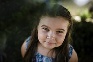 High angle portrait of cute girl standing at park - CAVF61551