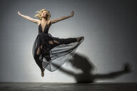 Blond woman dancing in black dress - VGF00215