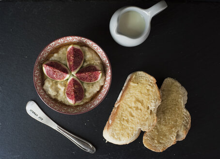 Overhead view of fresh breakfast served on slate at home - CAVF61724