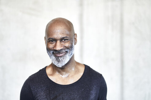 Portrait of sweating bald man with grey beard - FMKF05422