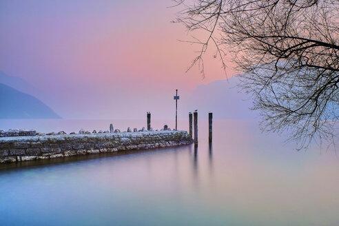 Italy, Torbole, Lake Garda, jetty at sunset - MRF01934