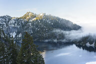 High angle view of calm lake amidst mountains against sky during winter - CAVF61779