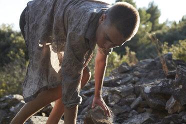 France, teenage boy climbing on rocks - AMEF00012