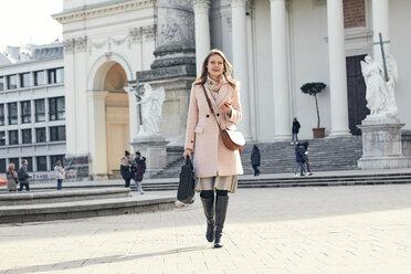 Austria, Vienna, Austria, Vienna, young businesswoman with laptop bag crossing Karlsplatz - ZEDF01925