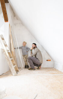 Father and son planning loft conversion - MFRF01166