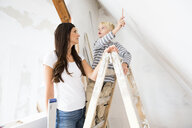 Mother and son working on loft conversion - MFRF01175