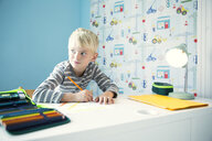 Boy doing homework at desk in children's room - MFRF01220