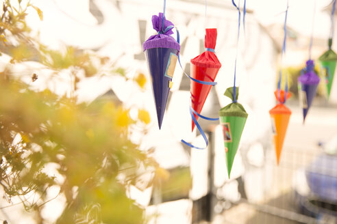 Miniature school cones hanging in a row - MFRF01226