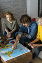 Friends meeting to plan vacations, checking map - AFVF02508