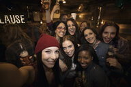 Portrait smiling women friends drinking beer at party - HEROF26349