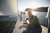 Portrait smiling mature man on sunny sailboat - HEROF26445