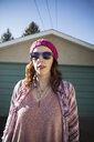 Portrait confident, cool hipster woman wearing sunglasses - HEROF26532