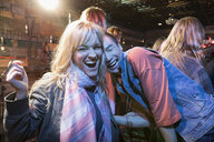 Portrait laughing couple enjoying party - HEROF26562
