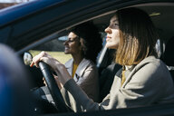 Two women driving in a car - JRFF02793