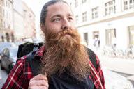 Male traveller hipster on streets, Berlin, Germany - CUF49314