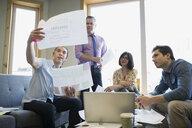 Business people discussing paperwork in meeting - HEROF26712