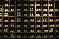 Bowling shoes organized in cubby shelves bowling alley - HEROF26814